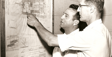 Joseph L. Mancuso (left) talks to Ray Stoll (right), the operations manager at the Batavia Industrial Center in the early days of the first U.S. Incubator.
