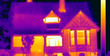 Thermal imaging for homes This thermal image shows the front of a house. Areas in yellow are warmer than areas in purple.